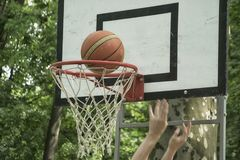 A close-up of a basketball field goal. Basketball player scores a point hitting the field goal stock photo