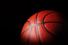 Basketball. Close up of a basketball over black Stock Image