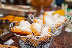 Close up baskets with freshly baked pastry goods on display in cafeteria shop. Selective focus Stock Photos