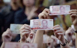 Close up of 100 bath Thai money on hand Stock Photo