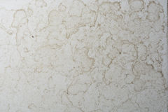 Close up of bathroom floor. Tile texture with water stain spot Royalty Free Stock Images