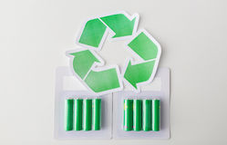 Close up of batteries and green recycling symbol Stock Image