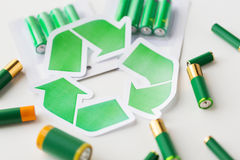 Close up of batteries and green recycling symbol Royalty Free Stock Image