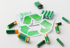 Close up of batteries and green recycling symbol Royalty Free Stock Photos