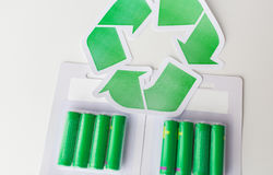 Close up of batteries and green recycling symbol Royalty Free Stock Photo