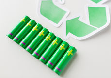Close up of batteries and green recycling symbol Royalty Free Stock Photography