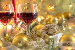 Close-up of bauble,candle and red wine. Stock Images