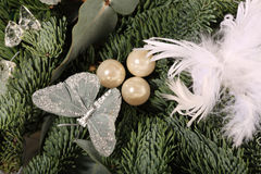 Close up of baubles and white feathers on a wreath Royalty Free Stock Image