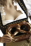 Close-up of Bavarian Girl with Oktoberfest Pretzel Stock Images