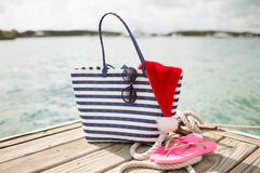 Close up of beach accessories and santa helper hat Royalty Free Stock Image