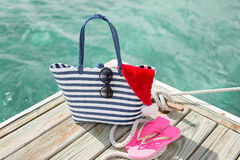 Close up of beach accessories and santa helper hat Royalty Free Stock Photos