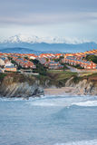 Close-up with the beach and the background mountains with snow on the coast Quebrada, Liencres, Cantabria Royalty Free Stock Photo