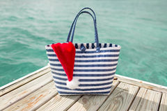 Close up of beach bag and santa helper hat Stock Images