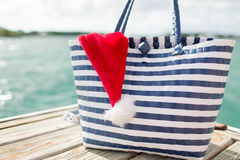 Close up of beach bag and santa helper hat Stock Image