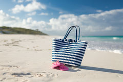 Close up of beach bag and slippers at seaside Stock Photo