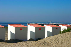 Close Up Beach Cabins with pier in background. Close Up of Beach cabins at the Belgian coast Royalty Free Stock Photo