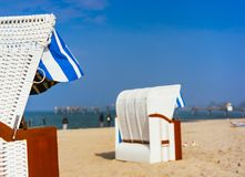 Close up of beach chairs on sandy beach on Travemuende, Luebeck Bay, Germany royalty free stock photos