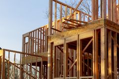 Close-up of beam built home under construction and blue sky with wooden truss, post and beam framework. Timber frame house, real stock photos