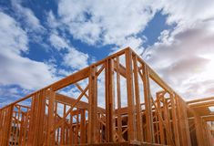 Close-up of beam built home under construction and blue sky with wooden truss, post and beam framework. Timber frame house, real. Close-up of beam built home royalty free stock images