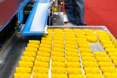 Close up bean dough loaf after press forming for asia or thai sweets on tray from belt conveyor of automatic food making machine. In production line for high royalty free stock image