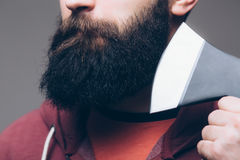 Close up of beard Confident young bearded man carrying a big axe on shoulder Royalty Free Stock Image