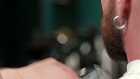 Close up of a beard trimming stock video