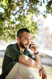 Close-up of bearded businessman calling over his phone Stock Photo
