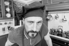 Close up of bearded chef expressing suspicion on his face royalty free stock photography