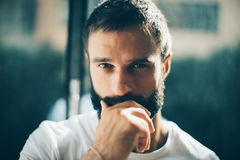 Close up of a bearded man wearing white tshirt Royalty Free Stock Photo