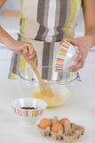 Close up beater eggs in bowl Stock Images