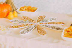 Close up of beatutyfully decorated salty snack to beer: roasted peanuts with small dried fish in fancy white bowls on catering tab Stock Photos