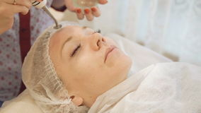 Close up of beautician doing skin treatment with ultrasonic machine stock footage