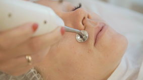 Close up of beautician doing skin treatment with ultrasonic machine stock video