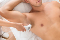 Close-up Of Beautician Giving Laser Epilation Treatment. High Angle View Of Beautician Giving Laser Epilation Treatment On Man's Armpit Stock Images