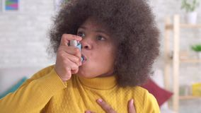 Close up Beautiful african woman american afro hairstyle sudden asthmatic attack is the use of spray slow mo. Close up Beautiful african woman american afro stock footage
