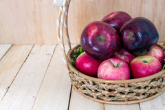 Close up of beautiful apples in wicker basket Royalty Free Stock Photography