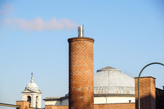 Close up of beautiful arabesque white chimney on the roof rising up in blue sky, Stock Photo