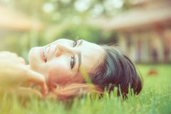 Beautiful asia Girl relaxing in park. stock photo