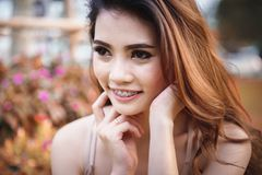 Beautiful asia Girl relaxing in park. royalty free stock photo
