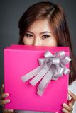 Close up beautiful Asian girl with a gift box Stock Photos