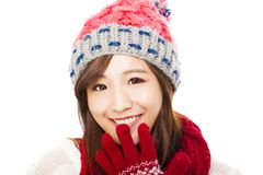 Close up of beautiful asian woman in hat, muffler and mittens. h Royalty Free Stock Images