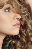 Close-up of beautiful blond woman with pierced nose looking away Stock Photo