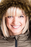 Close-up of beautiful blonde girl with fur hood on Royalty Free Stock Images