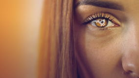 Beautiful blonde girl with future crypto currency in her eye. Close up of beautiful blonde girl with future crypto currency in her eye. Concept of crypto stock video