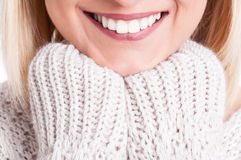 Close-up of beautiful blonde girl smile wearing sweater Royalty Free Stock Photography