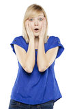 Close up of beautiful blonde woman in shock Stock Images