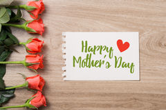 Close up of a beautiful bouquet of roses with a happy mothers day card. Mother's Day concept Royalty Free Stock Photography
