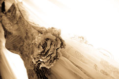 Close Up Beautiful Bridal Gown on a window balcony. Beautiful Bridal Gown hanging on a window balcony diagonal view royalty free stock image