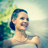 Close-up of beautiful bride looking at soap bubbles Royalty Free Stock Image