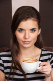 Close up of beautiful brunette drinking coffee. stock image